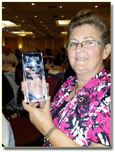 kathi-adkins-with-award1
